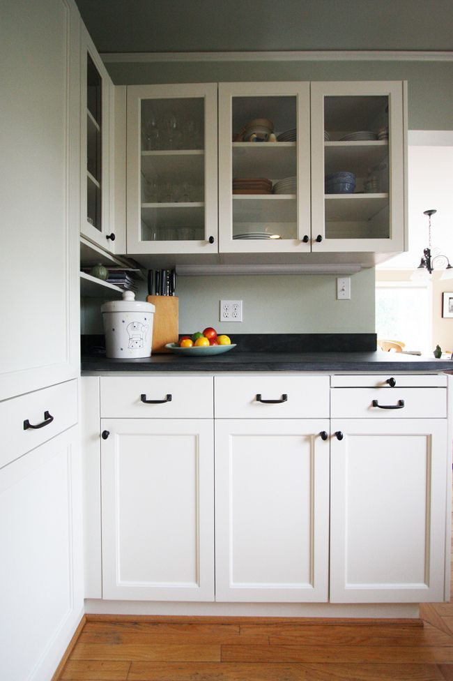Antique White Kitchen Cabinets with Bronze Hardware