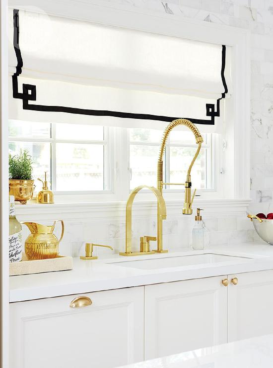 Black and White Kitchen Cabinets with Gold Accents