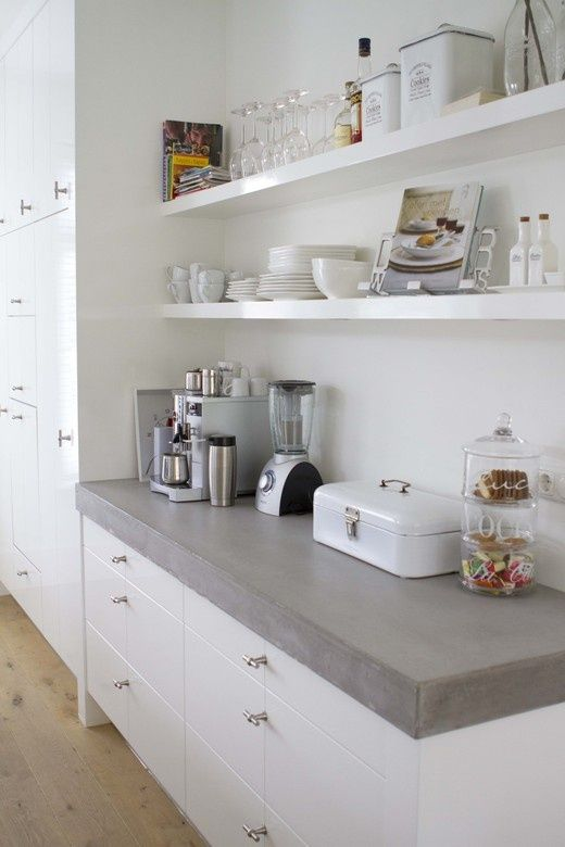 Concrete Kitchen Counter with White Cabinets