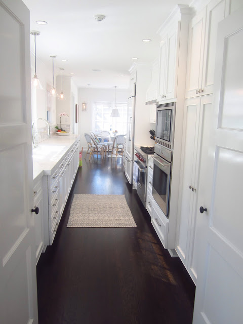 Galley Kitchen White Cabinets and Dark Floors