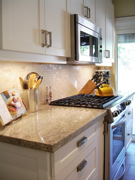 Galley Kitchen with White Cabinets and Granite Countertop