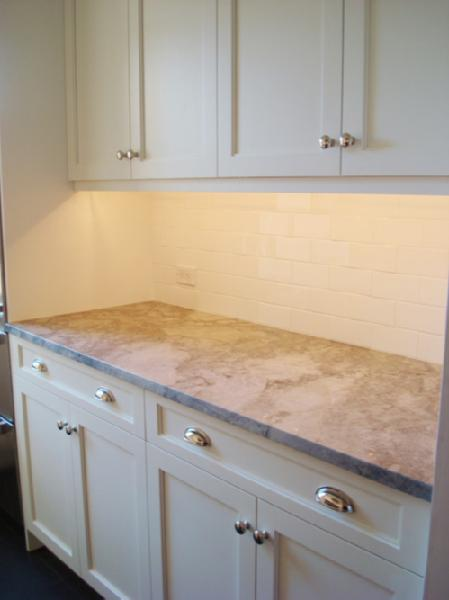 Granite Countertops with White Subway Tile Kitchen