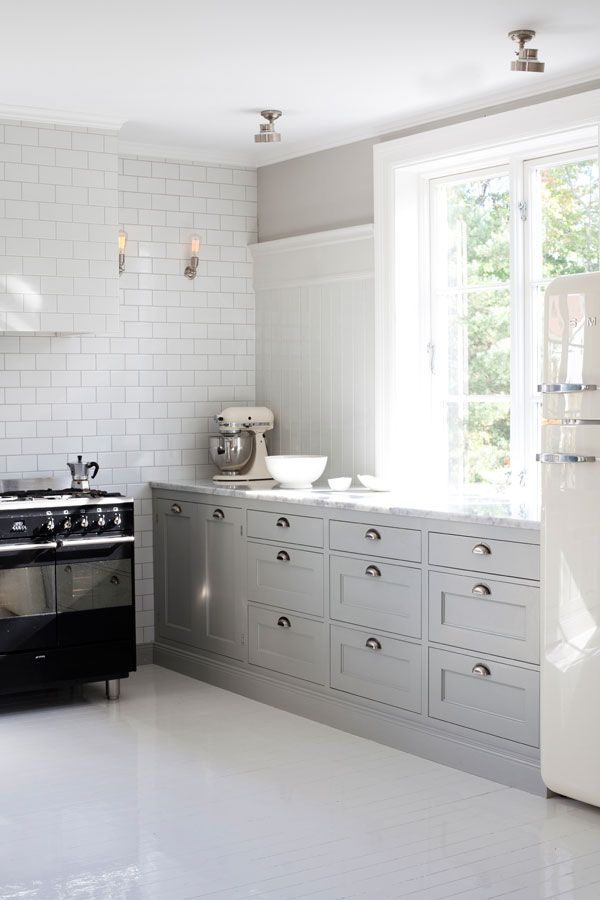 Grey and White Kitchen Cabinets with Subway Tiles
