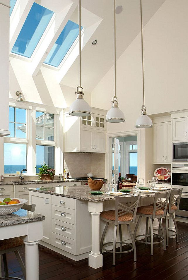 Kitchen and Vaulted Ceiling with Skylight