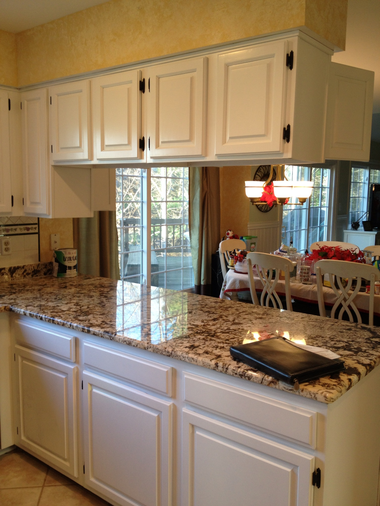 Kitchen with White Cabinets Brown Granite