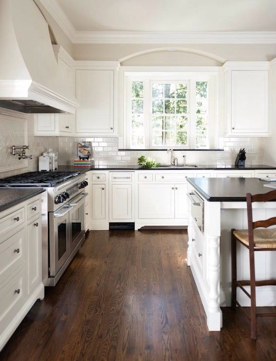 Kitchens with Dark Floors White Cabinets Black Countertops