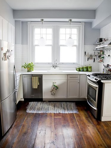 Small White Kitchen with Wood Floors