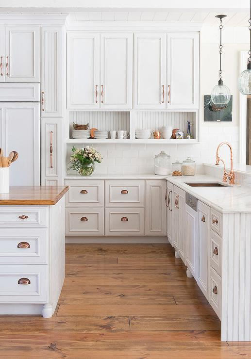 White Cabinets with Copper Pulls