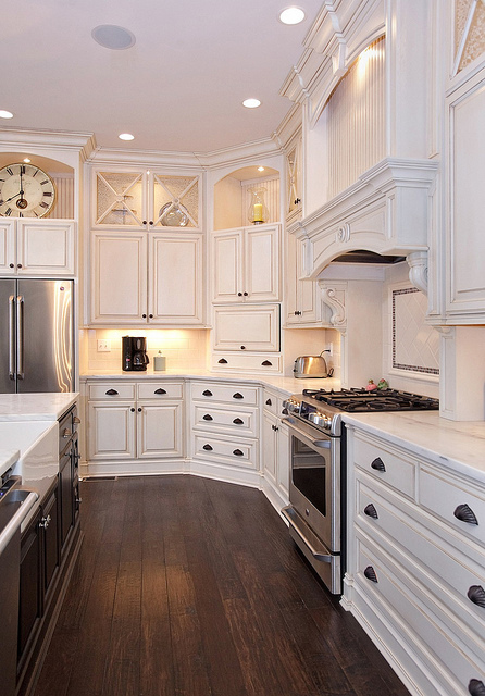 White Kitchen Cabinets with Dark Wood Floor