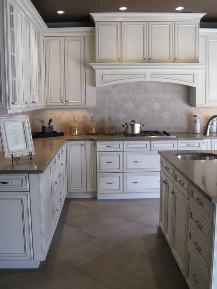 White Kitchen Cabinets with Pewter Glaze