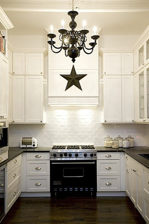 White Kitchen with Brick Backsplash