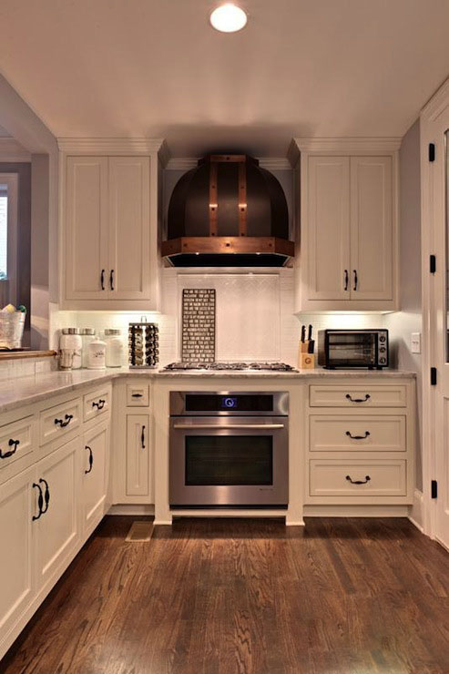 White Kitchen with Copper Hood