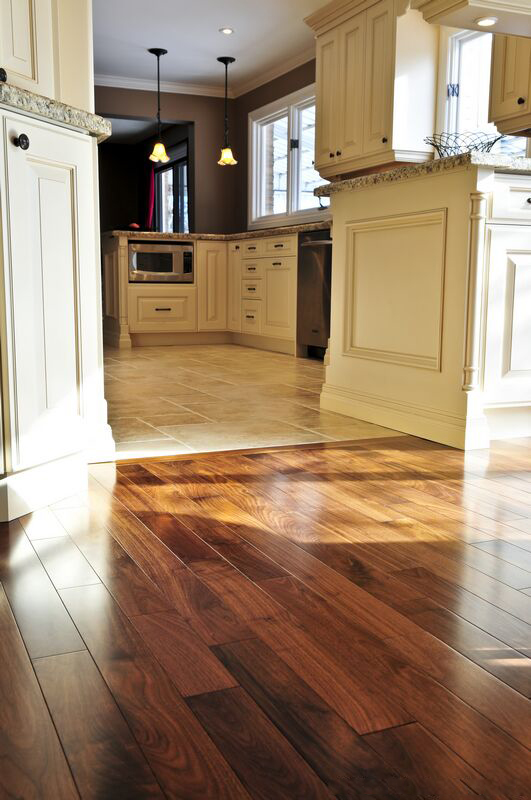 White Kitchen with Hardwood Floor Tile