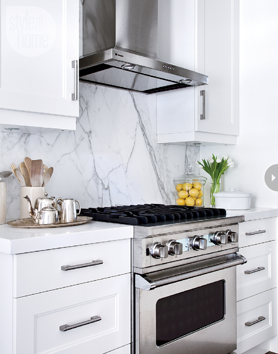 White Marble Slab Backsplash with Quartz Countertops