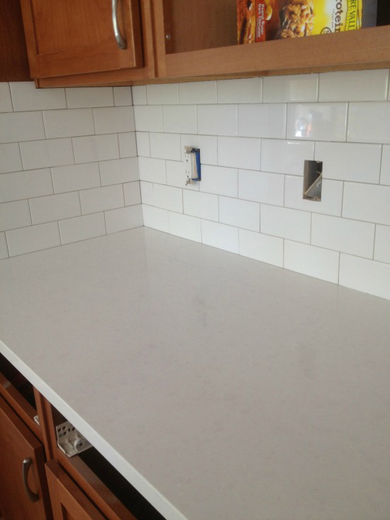 White Subway Tile with Quartz Countertops