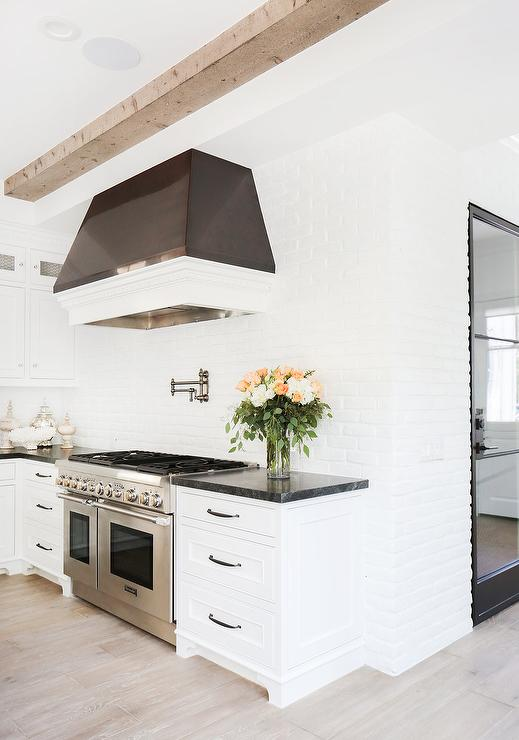 Black and White Kitchen with Brick