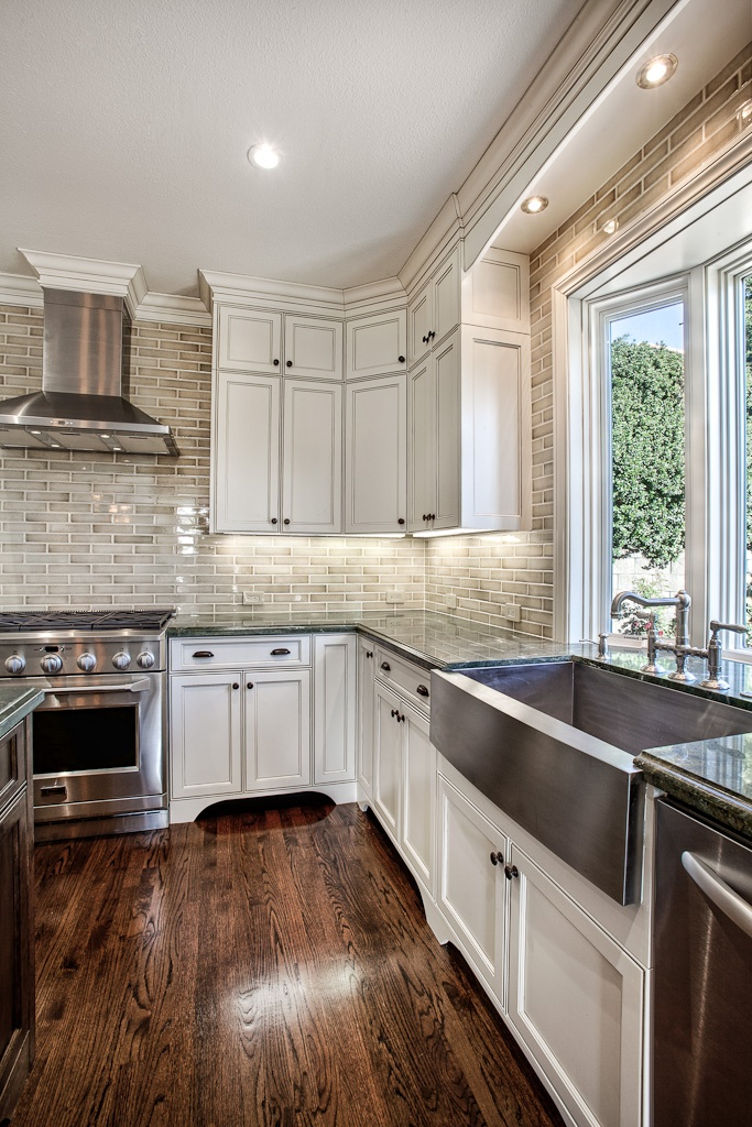 Dark Wood Floors with White Cabinets and Backsplash
