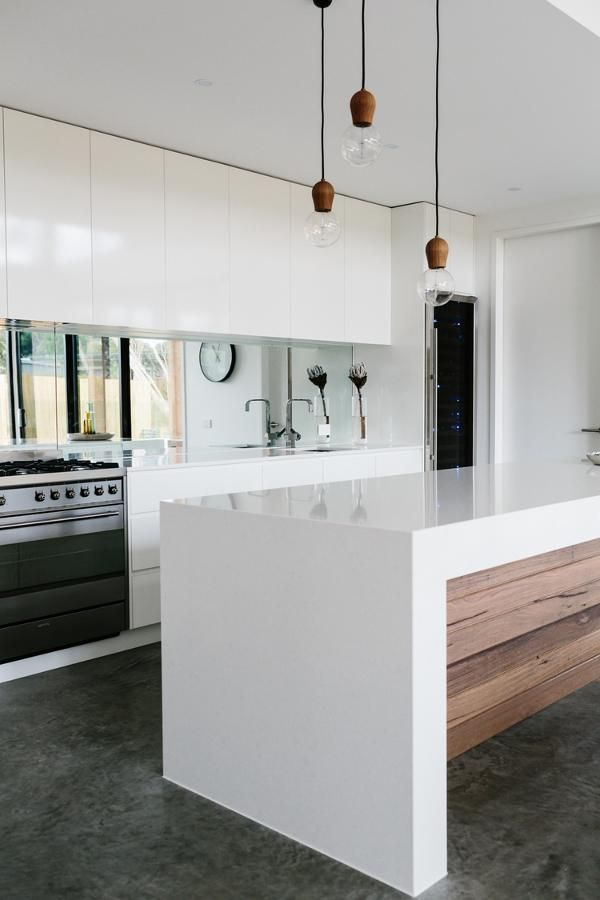 Modern White Kitchen with Concrete Floors