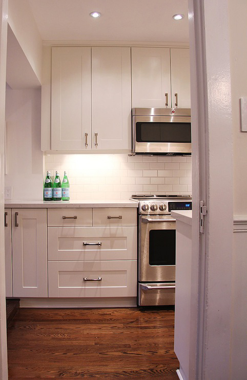 Stainless Steel Appliances with Off White Kitchen Cabinets