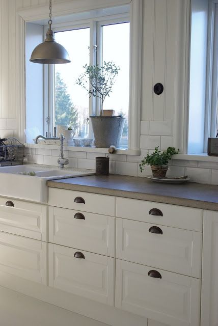 White Concrete Counter Tops and Cabinets