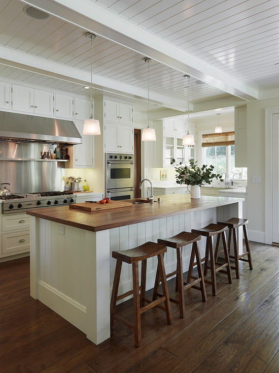 White Kitchen Island with Wood Ceilings