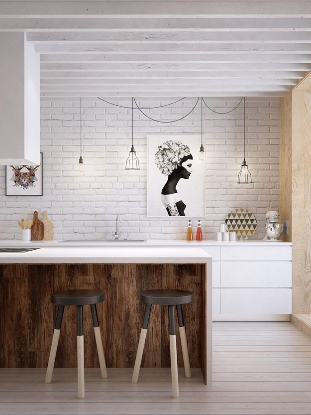 White Kitchen with Brick Wall