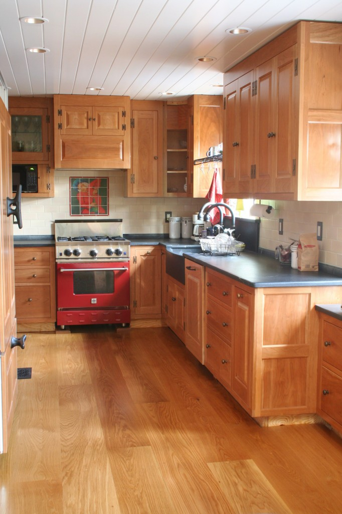 White Wood Floors with Oak Cabinets