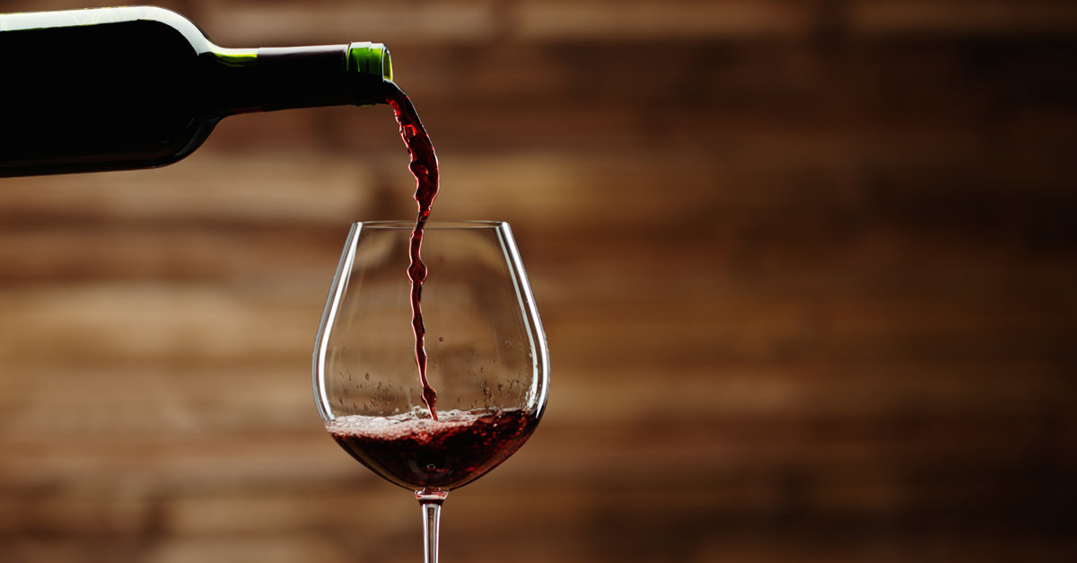 Wine pouring down through the pages of history across the millennia